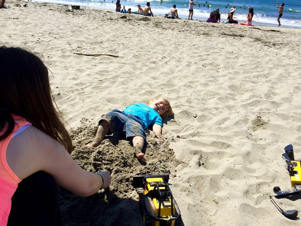 Blaise making sand angels